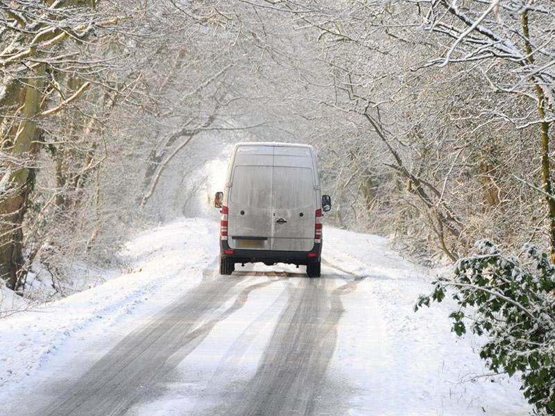 van driving in the snow